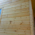 Log Siding Project. We keep our nail lines straight!