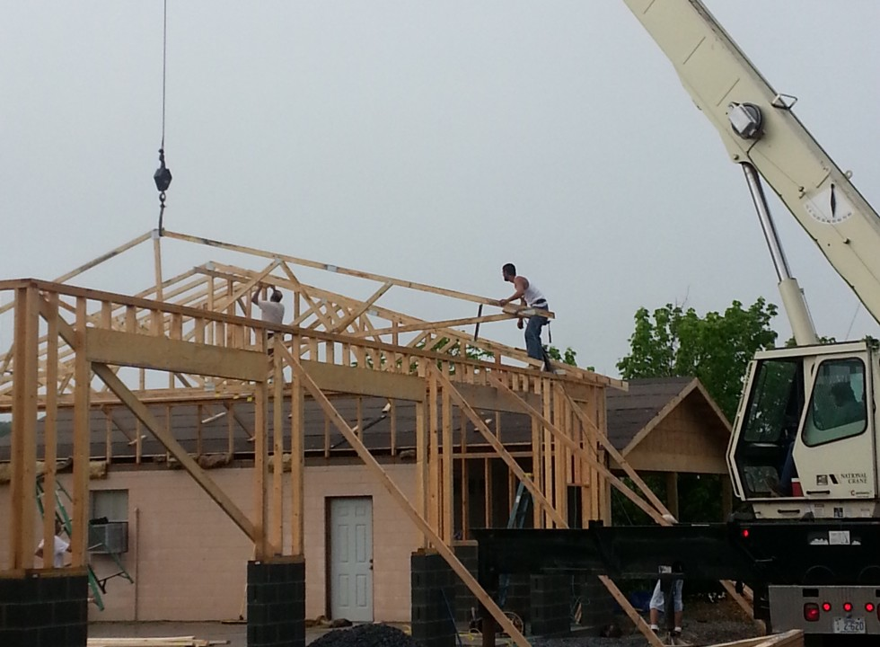 Setting Roof Trusses for a carport and garage.